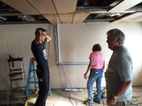 Jim and Nina Bayles making our office work again after getting a much needed expansion during shipyard.